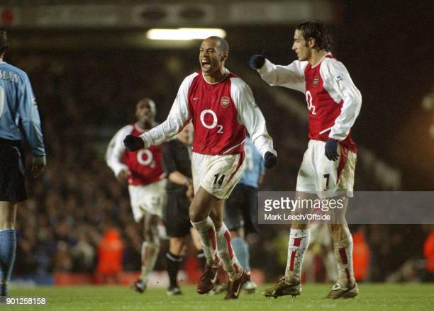 February 2004 London - FA Barclaycard Premiership - Arsenal v Manchester City :Thierry Henry of Arsenal celebrates his goal with Robert Pires .