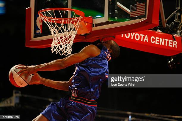 Philadelphia 76ers forward Andre Igoudala hits his head on the backboard as he goes up for a dunk in the Sprite Rising Stars SlamDunk competition at...