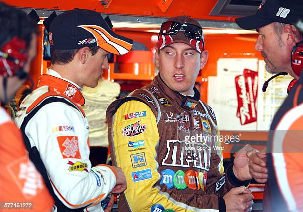 Kyle Busch talking to Joey Logano in the garage area during practice for the Sprint Cup Series Daytona 500 held at the Daytona International Speedway...