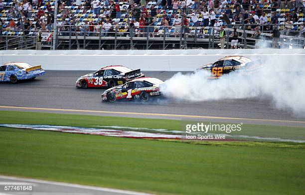 Mike Bliss on the front straight away with smoke coming from the car during the Nationwide Series Camping World 300 held at the Daytona International...