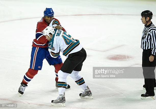 San Jose Sharks' Jody Shelley and Montreal Canadiens' Georges Laraque get 5 minutes penalty for fighting during the first period at the Bell Centre...