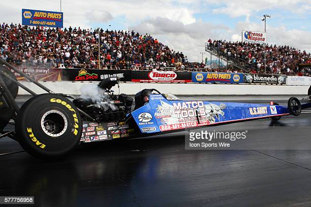 Antron Brown's Top Fuel dragster looses a rear wheel causing a firey crash during first round eliminations for the NHRA Arizona Nationals at Firebird...