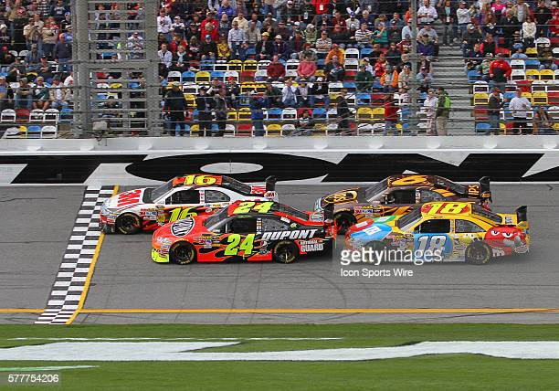 Greg Biffle , Jeff Gordon , David Ragan , and Kyle Busch on the straight away during race 1 of the Sprint Cup Series Gatorade Duels held at the...