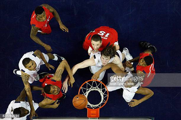 Nevada's Brandon Fields Luke Babbitt Dario Hunt and Joey Shaw with Fresno State's Jerry Brown Jr Nedeljko Golubovic and Paul George during the NCAA...