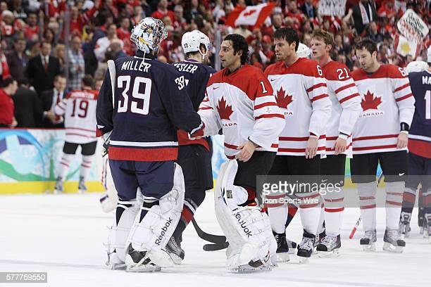 USA's goalie Ryan Miller and Canada's goalie Roberto Luongo shake hands at the end of the Gold medal Hockey Final between the United States and...