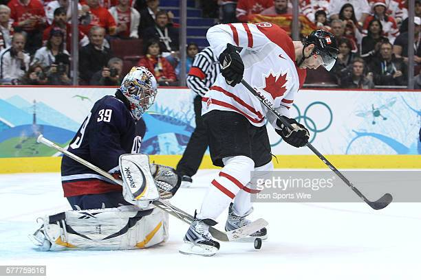 USA's goalie Ryan Miller and Canada's Joe Thornton keep an eye on the rebound during the Gold medal Hockey Final between the United States and Canada...