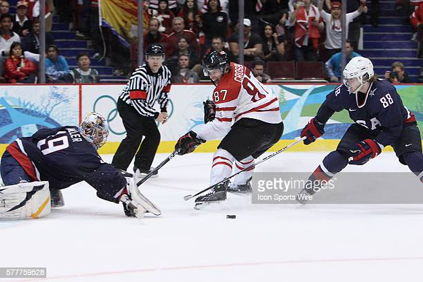 USA's goalie Ryan Miller makes save on Canada's Sidney Crosby as USA's Patrick Kane looks on during the Gold medal Hockey Final between the United...