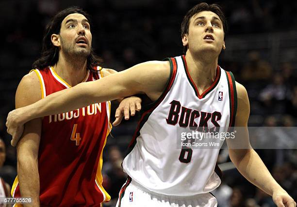 Houston Rockets forward Luis Scola from Argentina and Milwaukee Bucks center Andrew Bogut from Australia position for a rebound in the third quarter...