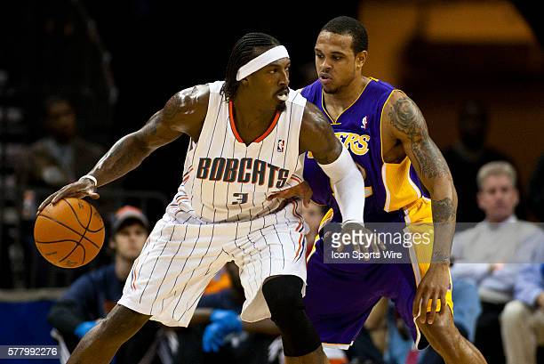 Charlotte Bobcats small forward Gerald Wallace looks to drive against Los Angeles Lakers point guard Shannon Brown during an NBA basketball game at...