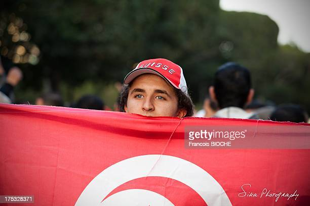 February 2013 after the political assasination of Chokri Belaid in Tunisia. A march was organized to protest against political violence, this young...