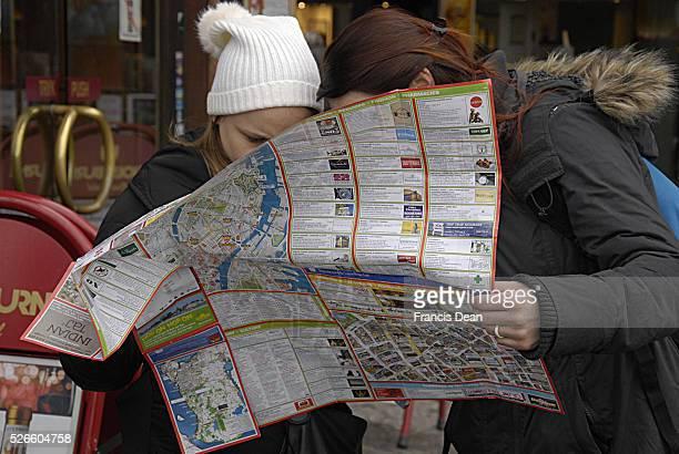 February 2014 _Felame travelers studing Copenhagen city map at kongens nytorv