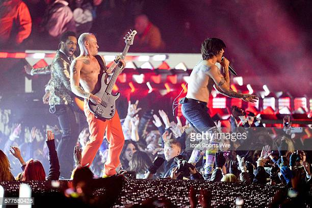 Bruno Mars performs with the Red Hot Chili Peppers in the Superbowl Halftime Show during Super Bowl XLVIII between the Denver Broncos and the Seattle...