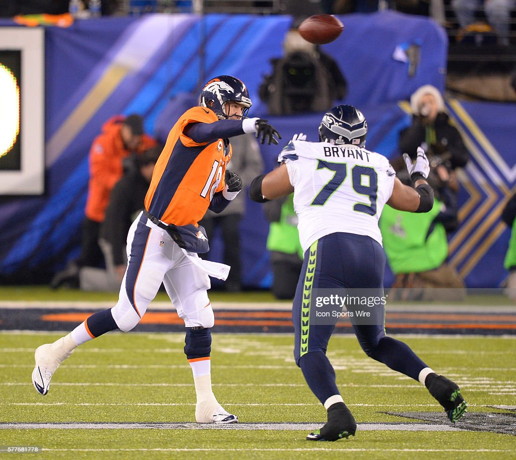 Denver Broncos Quarterback Peyton Manning Throws A Pass