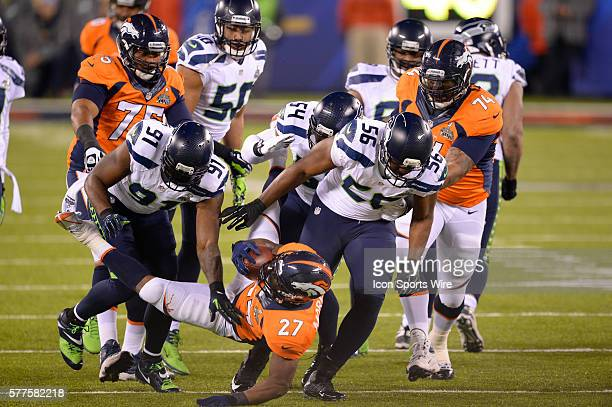 Denver Broncos running back Knowshon Moreno is tackled by Seattle Seahawks defensive end Chris Clemons Seattle Seahawks middle linebacker Bobby...