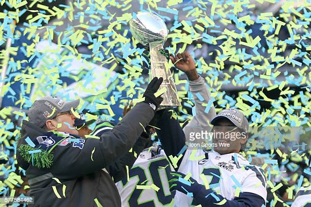 Seattle Seahawks owner Paul Allen and quarterback Russell Wilson hoisted the Super Bowl trophy up in the air together Seattle Seahawks players and...