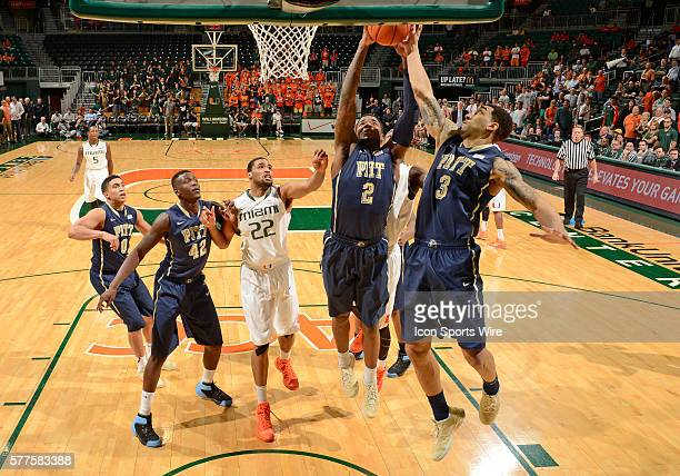 University of Pittsburgh forward Michael Young and guard Cameron Wright reach for a rebound against the University of Miami in Pitt's 5955 overtime...