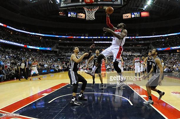 Washington Wizards point guard John Wall in action against San Antonio Spurs shooting guard Danny Green at the Verizon Center in Washington DC where...