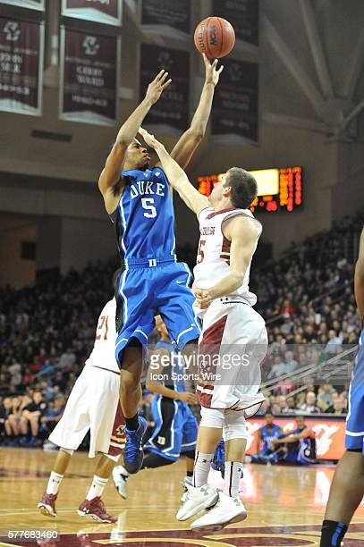 Duke Blue Devils forward Rodney Hood goes up over Boston College Eagles guard Joe Rahon for the short jump shot during the Duke Blue Devils game...
