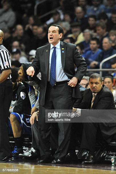 Duke Blue Devils head coach Mike Krzyzewski yells at his team from the sideline during the Duke Blue Devils game against the Boston College Eagles at...