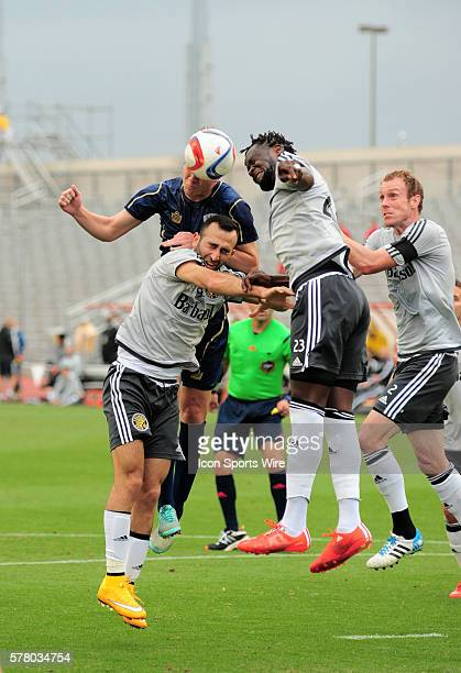 Columbus Crew midfielders Justin Meram Kei Kamara and Tyson Wahl go up for a header against Austin's Mikey Ambrose during 1 0 win over the Austin...