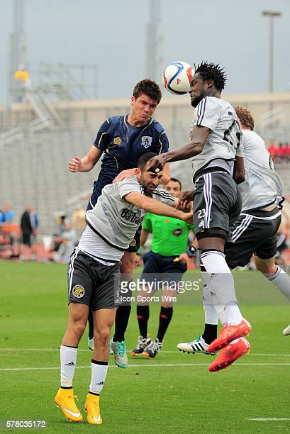 Columbus Crew midfielders Justin Meram, Kei Kamara and Tyson Wahl go up for a header against Austin's Mikey Ambrose during 1 - 0 win over the Austin...