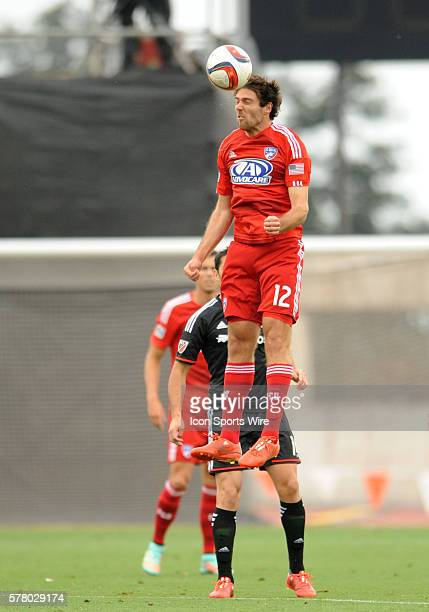 FC Dallas midfielder Ryan Hollingshead heads a ball during 1 0 loss to DC United in preseason match at Mike A Myers Stadium in Austin TX