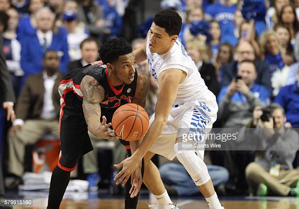 Kentucky Wildcats guard Devin Booker defends against Georgia Bulldogs guard Charles Mann in a game between the University of Georgia Bulldogs and the...