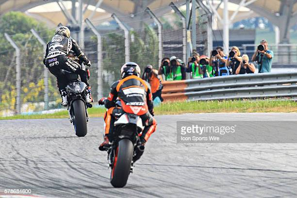 Scott Redding of Marc VDS Racing Team and Loriz Baz of NGM Forward Racing in action during the third day of the second official MotoGP testing...