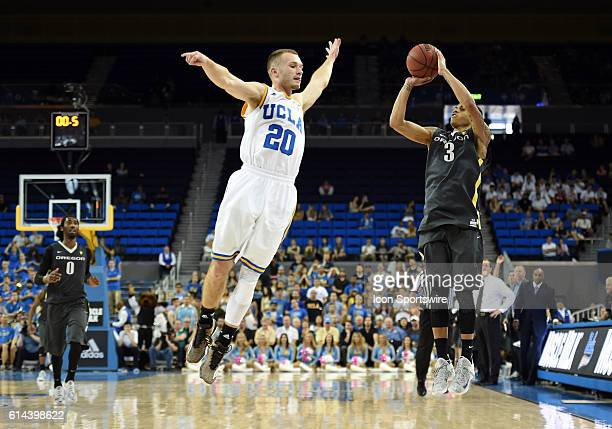 UCLA Bryce Alford attempts to block a halftime buzzer beater shot by Oregon Joseph Young during an NCAA basketball game between the Oregon Ducks and...