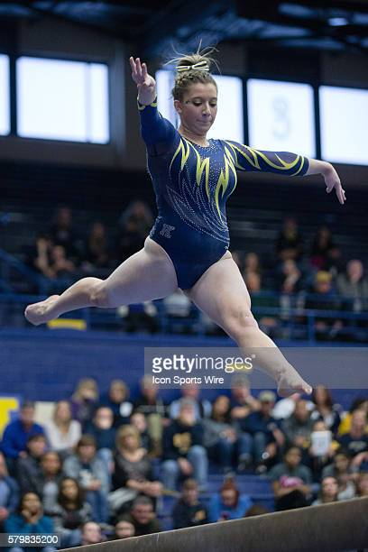 Ali Marrero competes on the Balance Beam during the meet between the George Washington Colonials, Northern Illinois Huskies and Kent State Golden...