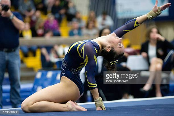 Alyssa Quinlan of Kent State competes in the Floor Exercise during the meet between the George Washington Colonials Northern Illinois Huskies and...