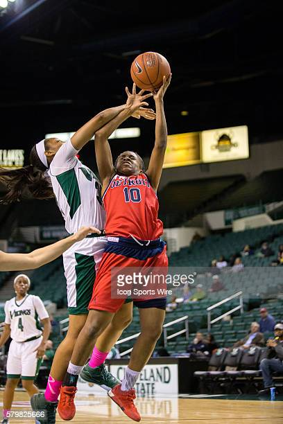 Detroit Titans G Brittney Jackson is fouled by Cleveland State Vikings Forward Shadae Bosley during the second half of the NCAA Women's Basketball...
