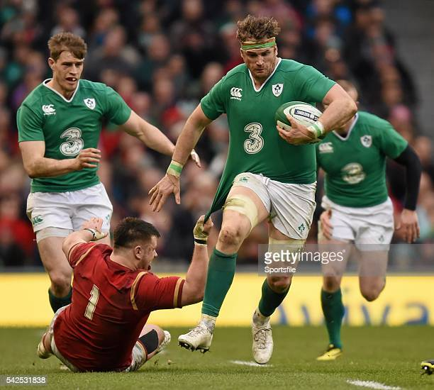 February 2016; Jamie Heaslip, Ireland, is tackled by Rob Evans, Wales. RBS Six Nations Rugby Championship 2016, Ireland v Wales. Aviva Stadium,...