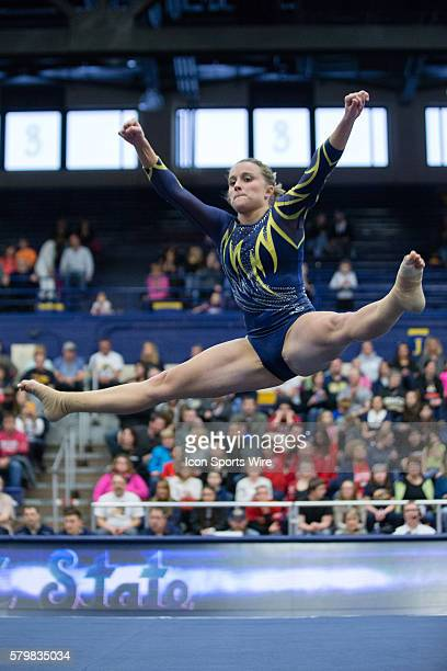Kayla Kosmerl of Kent State competes in the Floor Exercise during the meet between the George Washington Colonials Northern Illinois Huskies and Kent...