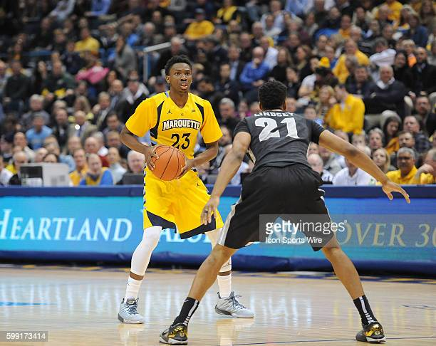 Marquette Jajuan Johnson looks to set up the offense against Providence Jalen Lindsey during an NCAA basketball game between the Providence Friars...