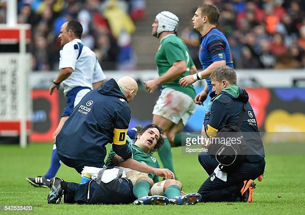 13 February 2016 Mike McCarthy Ireland is attended to by team doctor Dr Jim McShane and team physio James Allen before being stretchered off RBS Six...