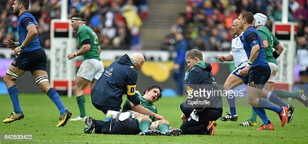 13 February 2016 Mike McCarthy Ireland is attended to by team doctor Dr Jim McShane and team physio James Allen before being stretchered off as play...