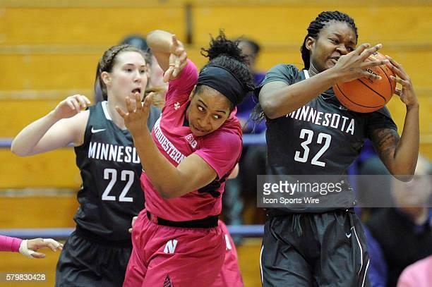 Minnesota Golden Gophers center Karley Barnes grabs the rebound next t Northwestern Wildcats forward Pallas KunaiyiAkpanah and Minnesota Golden...