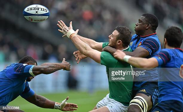 13 February 2016 Robbie Henshaw Ireland loses possession under pressire from Virimi Vakatawa left and Yacouba Camara France RBS Six Nations Rugby...