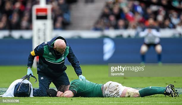 13 February 2016 Sean O'Brien receives treatment from team doctor Dr Eanna Falvey after picking up an injury RBS Six Nations Rugby Championship...