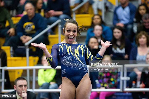 Skyelee Lamano of Kent State competes in the Floor Exercise during the meet between the George Washington Colonials Northern Illinois Huskies and...