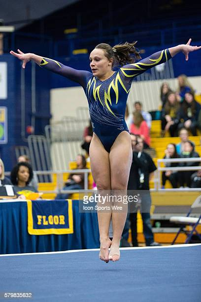 Skyelee Lamano of Kent State competes in the Floor Exercise during the meet between the George Washington Colonials, Northern Illinois Huskies and...