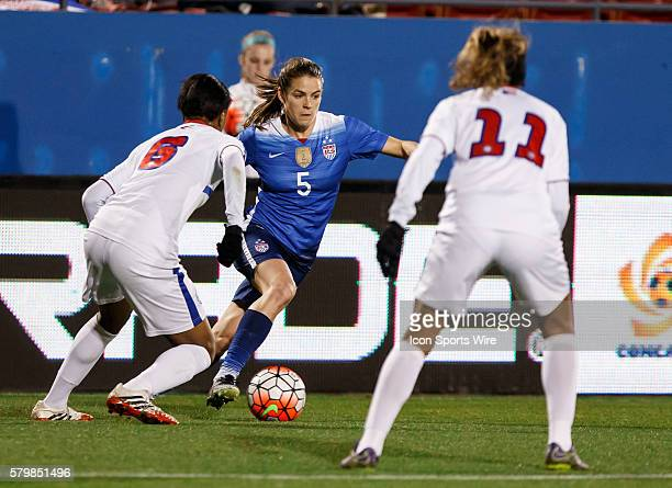 15 February 2016 United States defender Kelley O'Hara dribbles as Puerto Rico forward Ashley Johnson defends during the Olympic Qualifying first...