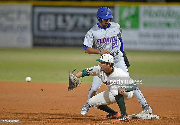 University of Miami infielder/outfielder Christopher Barr waits for the ball as University of Florida outfielder Buddy Reed returns to first at Alex...