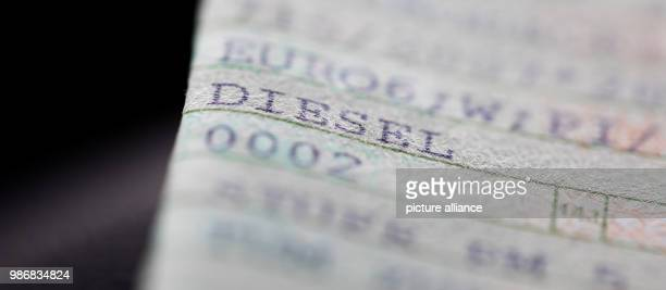 The word DIESEL is printed on a vehicle registration document The air within German urban areas has worsened The nitrogen oxide levels have been...