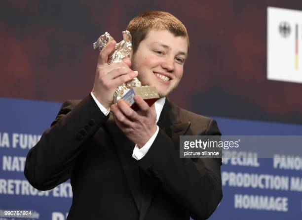 24 February 2018 Germany Berlin Award Ceremony Berlinale Palace The French actor Anthony Bajon holds up his silver bear for Best Actor for the film...