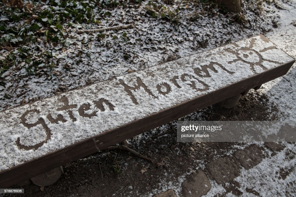 Unknown People Wrote Guten Morgen Sonne On A Snow Covered