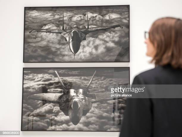 A visitor looks at the exhibited art works 'Untitled ' and 'Untitled ' of artist Robert Long during press tour of the exhibition 'Proof Francisco...