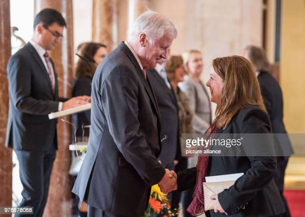 The Bavarian Premier Horst Seehofer of the Christian Social Union welcomes the consular corps among them Jennifer Gavito America during the...