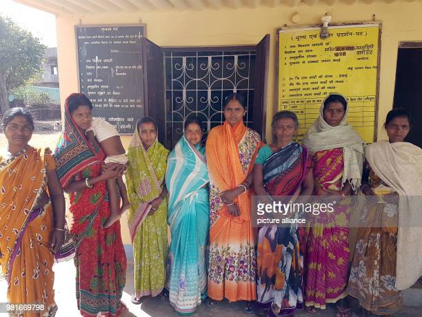 Women stand in front of a hand out office for subsidised rice Many problems occurred during the combination of the hand out system with the ID...